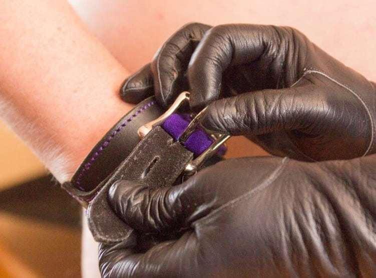 Slave restrained, bound in cuffs,