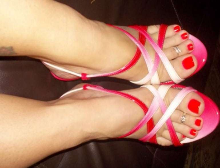 Sexy feet in strappy sandals
